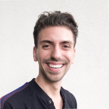 Andrew Dalton smiling and wearing a black shirt.